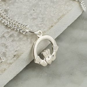 Childrens Silver Claddagh Pendant & Chain In Sterling Silver. Handcrafted Galway Claddagh Pendant for Children in Hallmarked 925 Silver on ShopStreet.ie Claddagh Pendants. Communion Gift & Confirmation Gift.