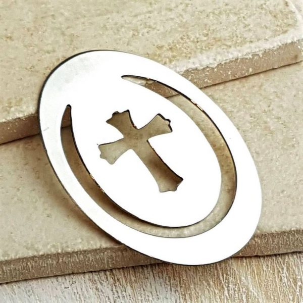 Silver Christian Cross Bible Bookmark. Sterling Silver Bible Bookmark with oval shaped body & cut-out cross symbol, framed by a horse shoe shaped cut-out.
