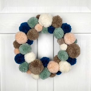 Handmade Christmas Wreath in Beige and Pearl Pom Pom. Handmade for Interior Design and Christmas Door Decoration.