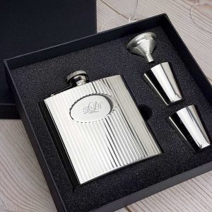 Personalised Ribbed Hip Flask Gift Set. Includes Hip Flask with lovely Ribbed finish, Two Cups, a Filling Funnel & Gift Box. PLUS Free Engraving and Optional Gift Wrapping.