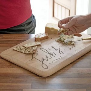 Personalised Cheeseboard in Beech Wood. Laser engraved script font Name Personalised Cheeseboard with Integrated handle in FSC Certified Beech Wood.