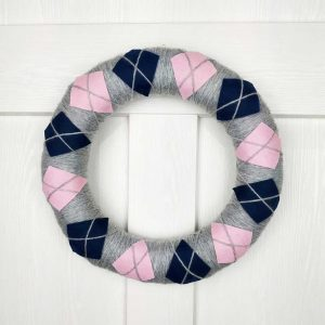 Handmade Sweater Style Wreath. Christmas & Home Wreath decorated with fluffy yarn and felt in three winter colours - grey, dark blue and pink.