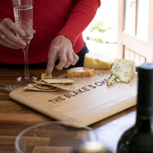 Personalised Cheeseboard in Beech Wood. Laser engraved Family Name Personalised Cheeseboard with Integrated handle in FSC Certified Beech Wood.