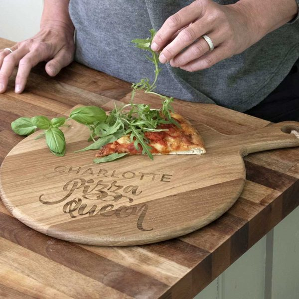 Personalised Pizza Board with Name Laser Engraved above the words Pizza Queen. Pizza Queen 12inch Oak Pizza Board with Handle & Jute Rope loop hanger.