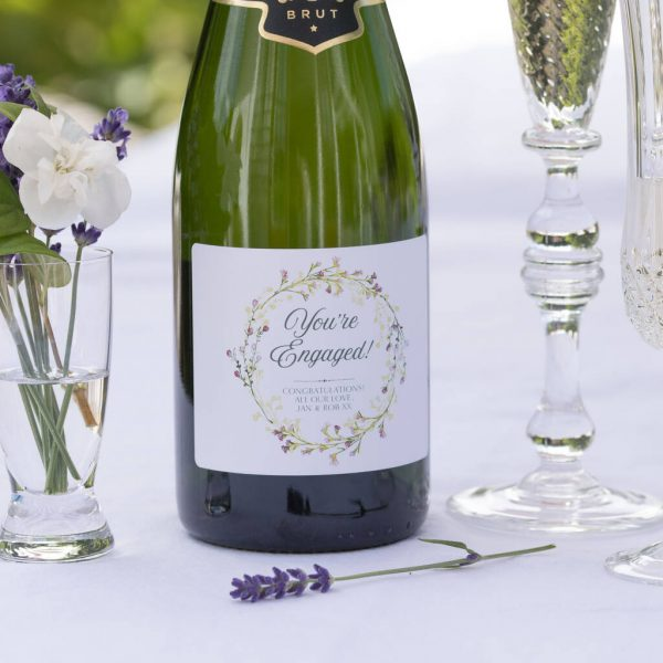 "Personalised Wedding Engagement Champagne Gift with Personal Message printed beneath ""You're Engaged!"". French Champagne with Personalised Label & Presentation Tube."