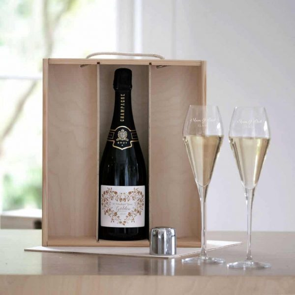 Golden Wedding Anniversary gift set featuring a Bottle Of Quality French Champagne with Dated Label, two Personalised Crystal Champagne Glasses and a Personalised Gift Box.