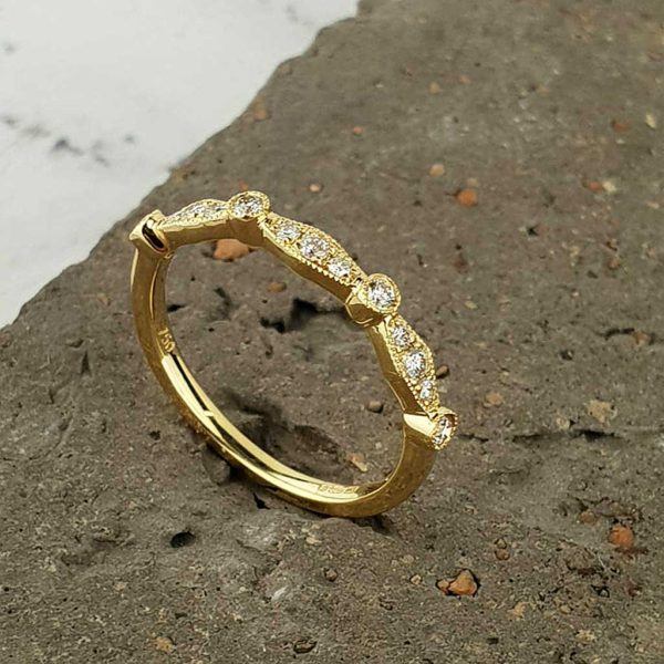 Handmade Eternity Ring In Diamond Set 18ct Gold. Hallmarked 18ct Gold Eternity Ring with hand-mounted line of exquisite diamonds totalling 0.9 carats Ireland.