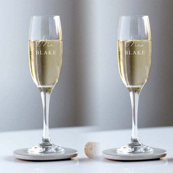 Personalised Mr & Mrs Champagne Glasses Engraved with Bride & Grooms Family Name in All Capital Font in personalised Crystal or Wedding Champagne Glass.