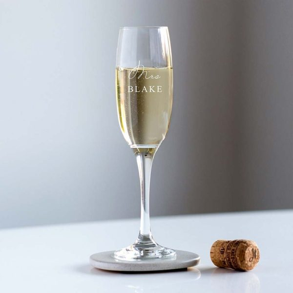 Personalised Mrs Champagne Glass Engraved with the Brides New Family Name in All Capital Font in personalised Crystal or Wedding Champagne Glass.