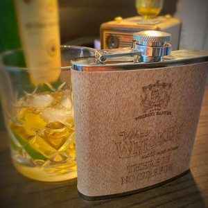 """Irish Whiskey Proverb Wood Clad Hip Flask. 6oz Whiskey Hip Flask laser etched in Galway, Ireland with """"What Whiskey Will Not Cure There is No Cure"""""""